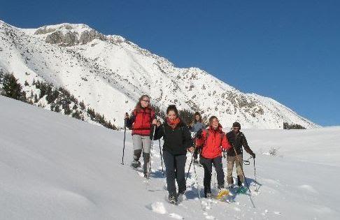 Met de sneeuwschoenen wandelen aan het Gardameer